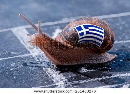 finish line winning of a snail with the colors of Greece flag - stock photo