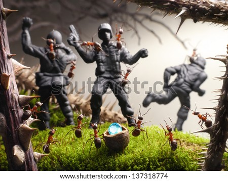 finish to tomb raiders, ant tales. ants pinch toy soldiers - stock photo
