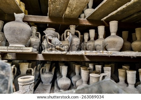 Finished pottery is still there in this old factory. - stock photo