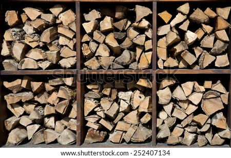Finished wood in the woodpile - preparation for the winter