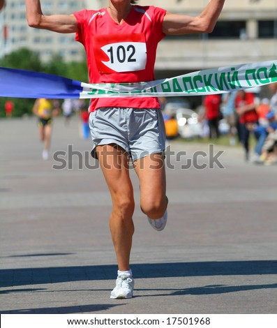 Finishing run woman at the marathon competition - stock photo