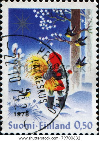 FINLAND - CIRCA 1992: A Christmas stamp printed in Finland shows boy in red hat in winter forest, circa 1992
