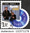 FINLAND - CIRCA 2012: A stamp printed in Finland shows band Agents, series on Finnish music has reached the 1990's, circa 2012  - stock photo