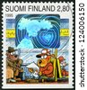 "FINLAND - CIRCA 1995: A stamp printed in Finland shows ""Dog Hill Kids"", sending/receiving greetings: On bus, girl friend, circa 1995 - stock photo"
