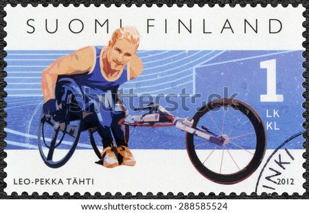 FINLAND - CIRCA 2012: A stamp printed in Finland shows Finnish Champions in disabled sports, wheelchair racer Leo-Pekka Tahti, series Summer Paralympic Games, circa 2012 - stock photo