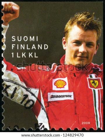 FINLAND - CIRCA 2008: A stamp printed in Finland shows Kimi Raikkonen F1 World Champion 2007, Motor racing, circa 2008 - stock photo