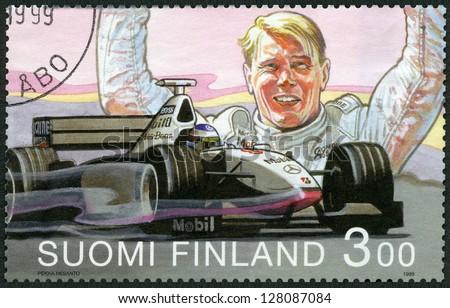 FINLAND - CIRCA 1999: A stamp printed in Finland shows Mika Hakkinen, Formula 1 Driving Champion 1998, circa 1999 - stock photo