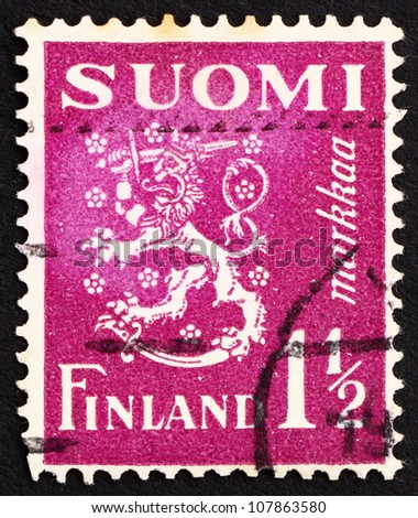 FINLAND - CIRCA 1930: a stamp printed in the Finland shows Crowned Lion Rampant, Arms of the Republic of Finland, circa 1930