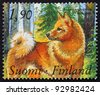 FINLAND - CIRCA 1989: a stamp printed in the Finland shows Finnish Spitz Dog, Centenary of Finnish Kennel Club, circa 1989 - stock photo