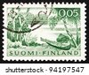 FINLAND - CIRCA 1961: a stamp printed in the Finland shows Lake and Rowboat, circa 1961 - stock photo