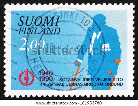 FINLAND - CIRCA 1990: a stamp printed in the Finland shows War Veteran, Disabled Veteran's Association, 50th Anniversary, circa 1990 - stock photo