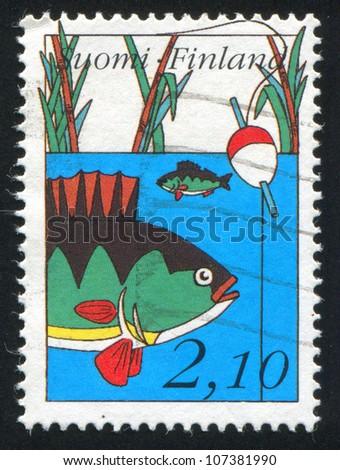 FINLAND - CIRCA 1991: stamp printed by Finland, shows Perch, bobber, circa 1991 - stock photo