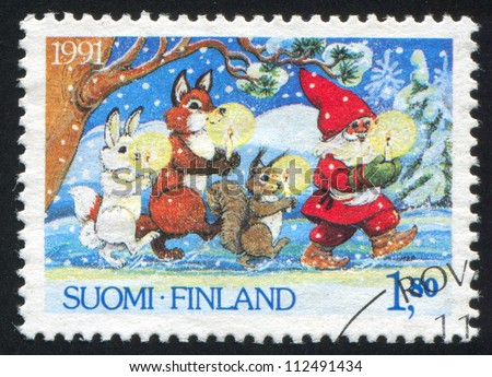 FINLAND - CIRCA 1991: stamp printed by Finland, shows Santa Claus and Animals Carrying Candles, circa 1991