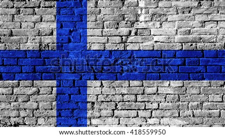 Finland flag on a brick wall surface - stock photo