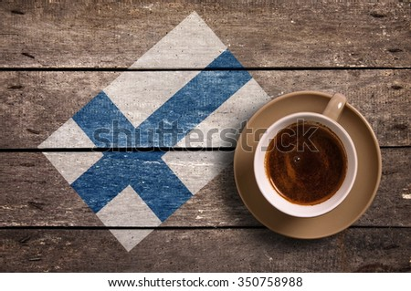 Finland flag with coffee on table. top view - stock photo