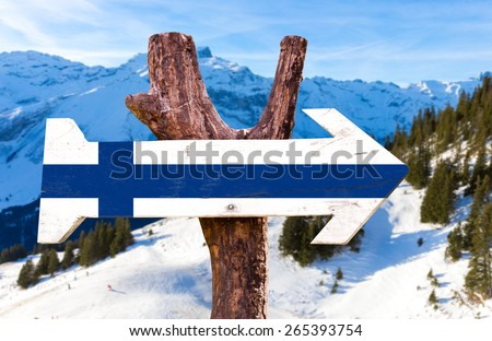 Finland flag wooden sign with alps background - stock photo