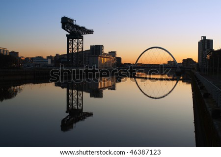 Finneston Crane and the Clyde Arc bridge in Glasgow in morning light - stock photo