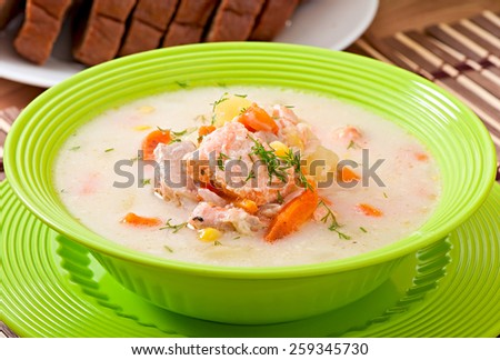 Finnish creamy soup with salmon - stock photo