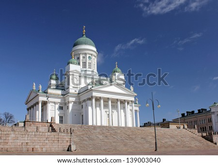 Finnish Evangelical Lutheran Cathedral of the Diocese of Helsinki against deep blue sky. - stock photo