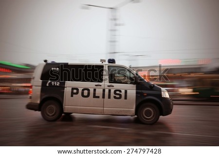 Finnish police car driving in Helsinki, Finland. Image includes a effect. - stock photo
