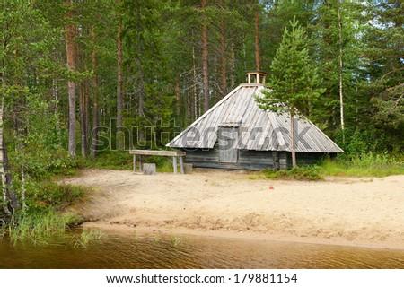 Finnish sauna on shore of lake, Northern Finland, Lapland - stock photo