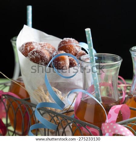 Finnish traditional Vappu food, sugar donuts with sima - stock photo