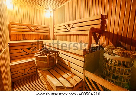 Finnish wooden modern sauna interior. Empty sauna with nobody in. Wooden sauna room. Interior of sauna steam wooden room. Spa and relax, healthcare complex.  - stock photo