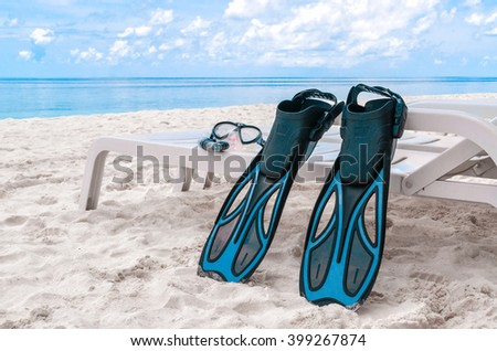 Fins and accessories for diving on the beach - stock photo