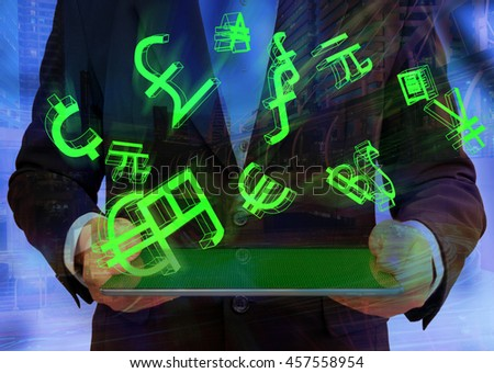 Fintech concept image. World currencies sign icon with man suit holding tablet abstract background.