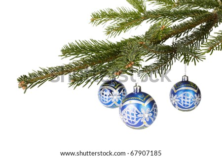 Fir branch with christmas toys on a white background. - stock photo