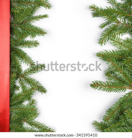fir branches border on white background with red ribbon, good for christmas backdrop - stock photo