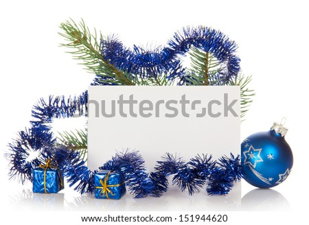 Fir-tree branch with tinsel, small gift boxes, a Christmas toy and a card isolated on white