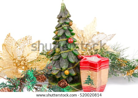 Fir tree candles and holly berry flowers  isolated on white background.