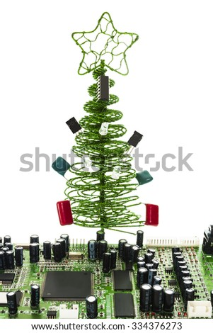 fir-tree for master on electric devices, decoration on a table under New Year