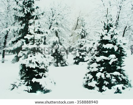 Fir-trees under snow - imitation of drawing a water color. The photo of a winter forest imitating drawing water color paints. The pine wood in the winter, is a lot of snow - drawing a water color. - stock photo