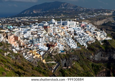 Fira city at Santorini island of the aegean sea at cyclades in Greece - stock photo