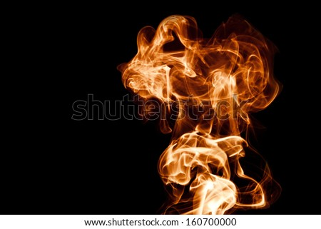 Fire abstract smoke on a black background - stock photo