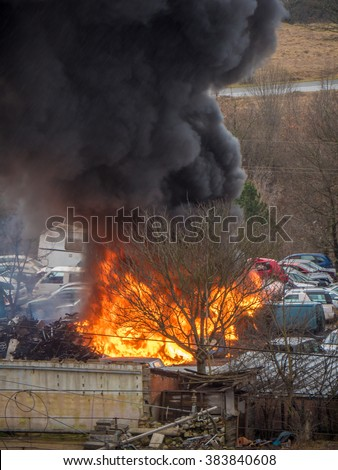 Fire accident explosion. Flaming fire accident. Car parking explosion fire accident. Black smoke, fire, explosion accident. Car service fire accident with explosion. Burning blaze cars fire accident. - stock photo