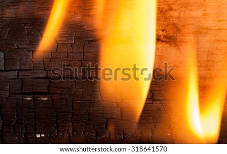 Fire against wooden - stock photo