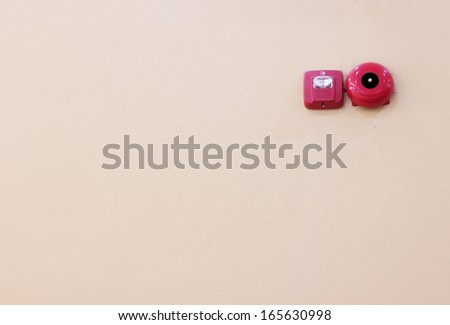 Fire alarm bell on the wall - stock photo