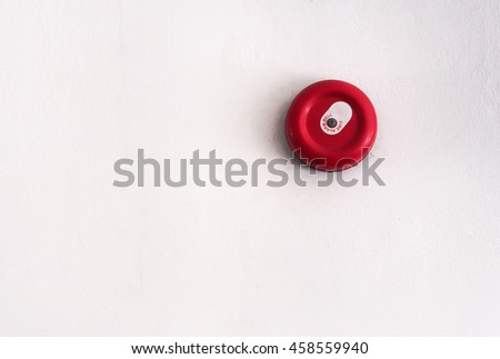 Fire alarm bell on the white wall - stock photo