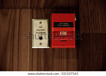 Fire Alarm Box on the Wooden Wall