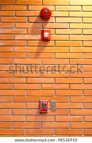 fire alarm on brick wall - stock photo