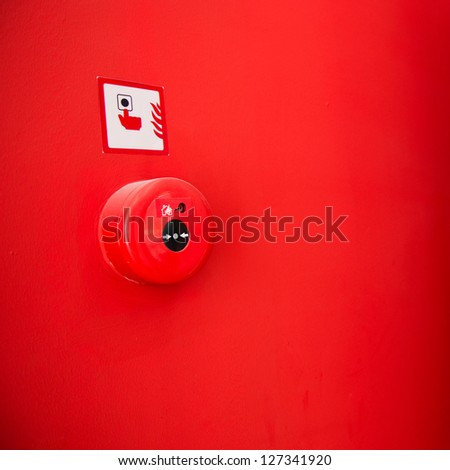 Fire alarm on the wall. - stock photo