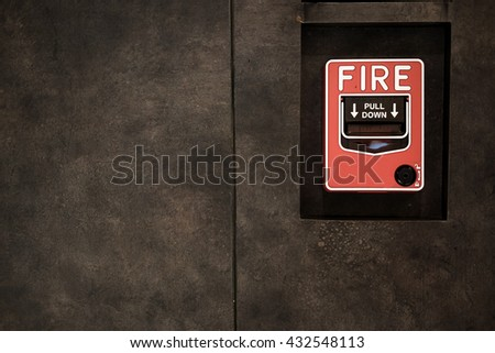 Fire alarm switch on factory wall in vintage tone,soft focus