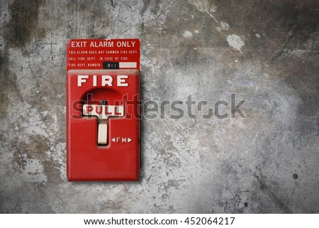 fire alarm switch on the grunge wall