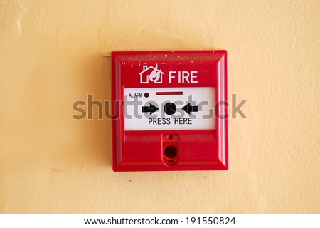 fire alarm switch on the wall - stock photo