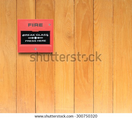 fire alarm switch on the wood wall background - stock photo
