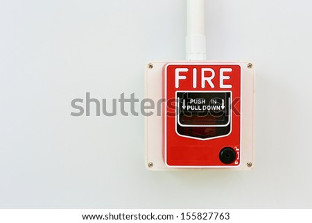 Fire alarm switch on white background.