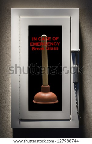 Fire alarm with a toilet plunger inside. - stock photo